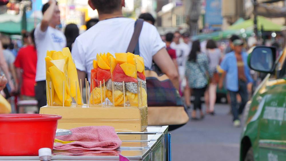Street scene and fruit stall on Khao San Road, Bangkok, Thailand, South Asia, Asia