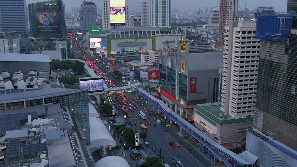 View of Bangkok skyline and Ratchadamri Road at dusk, Bangkok, Thailand, South Asia, Asia