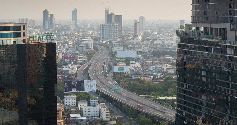 Elevated view of Sirat Expressway and the Business District at dusk, Bangkok, Thailand, South East Asia, Asia