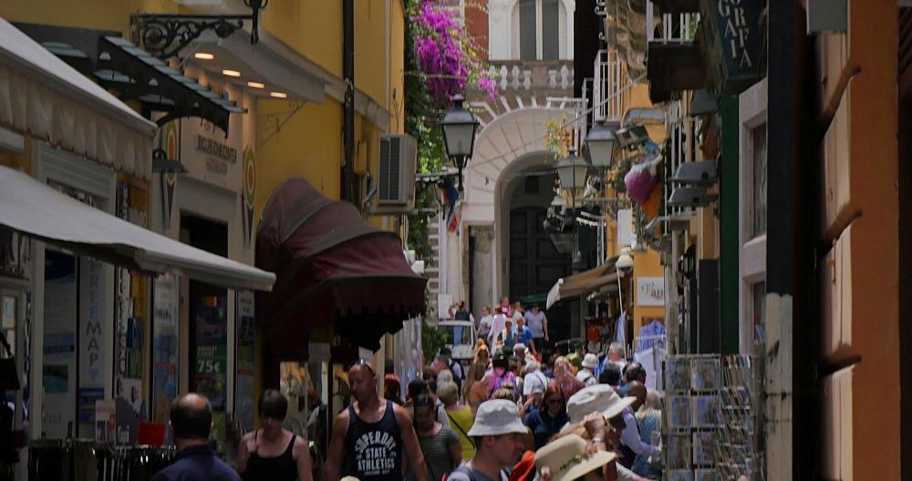 Shops on Narrow street and clock tower, Sorrento, Costiera Amalfitana (Amalfi Coast), UNESCO World Heritage Site, Campania, Italy, Europe