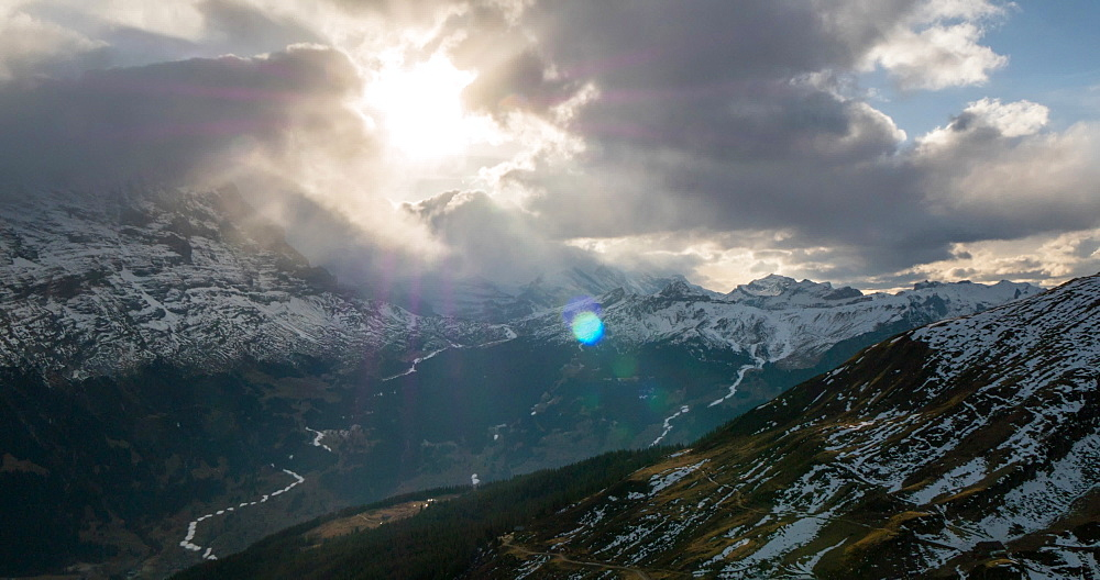 Setting sun, storm clouds and The Eiger, Grindelwald village from First, Jungfrau region, Bernese Oberland, Swiss Alps, Switzerland, Europe