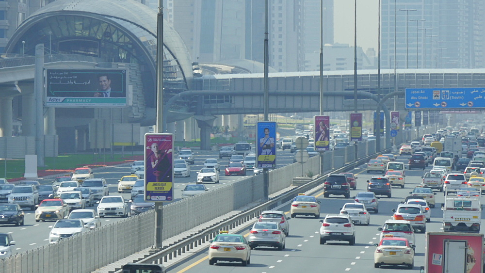 Traffic on Sheikh Zayed Road and Metro in Downtown, Dubai, United Arab Emirates, Middle East, Asia
