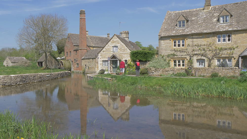 Reflection of Old Mill Museum in River Eye in Lower Slaughter, Cotswolds, Gloucestershire, England, United Kingdom, Europe