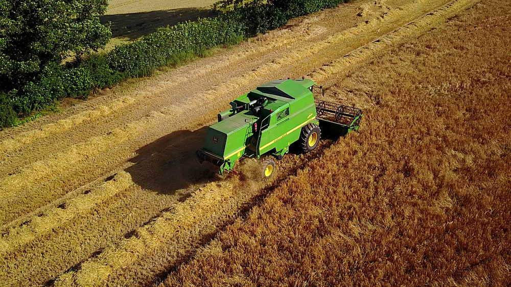 View of combine harvester at Ault Hucknall, Glapwell, Chesterfield, Derbyshire, England, United Kingdom, Europe