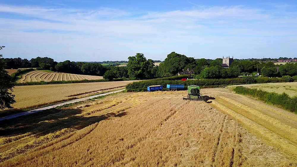 View of combine harvester at Ault Hucknall, Glapwell, Chesterfield, Derbyshire, England, Unitd Kingdom, Europe