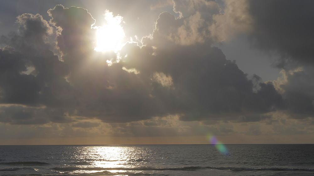 Sun through broken cloud at dawn, Miami Beach, South Beach, Miami, Florida, United States of America, North America