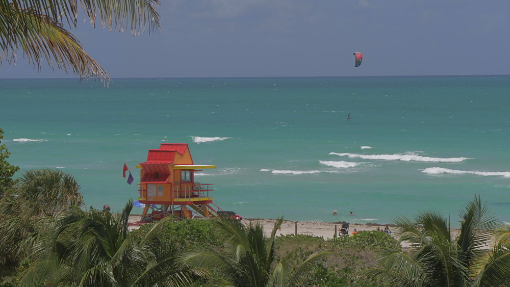Elevated shot of colourful lifeguard watchtower and waterspouts activity on Miami Beach, South Beach, Miami, Florida, United States of America, North America
