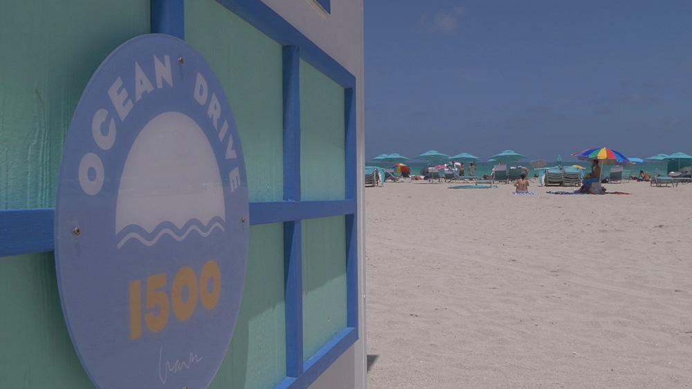 Lifting shot of beach hut and sunshades on Miami Beach, South Beach, Miami, Florida, United States of America, North America