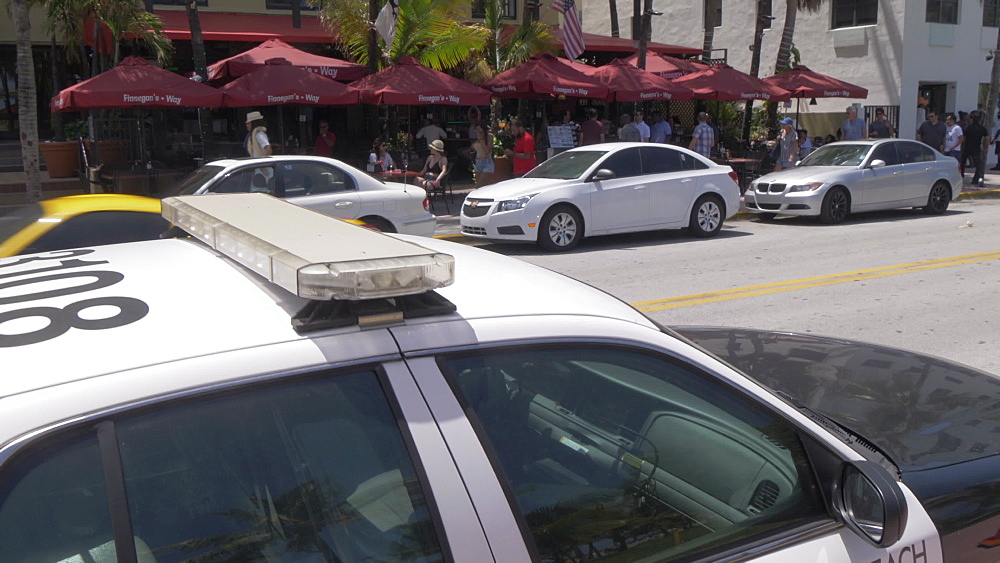 Black and white police car on Ocean Drive, South Beach, Miami, Florida, United States of America, North America