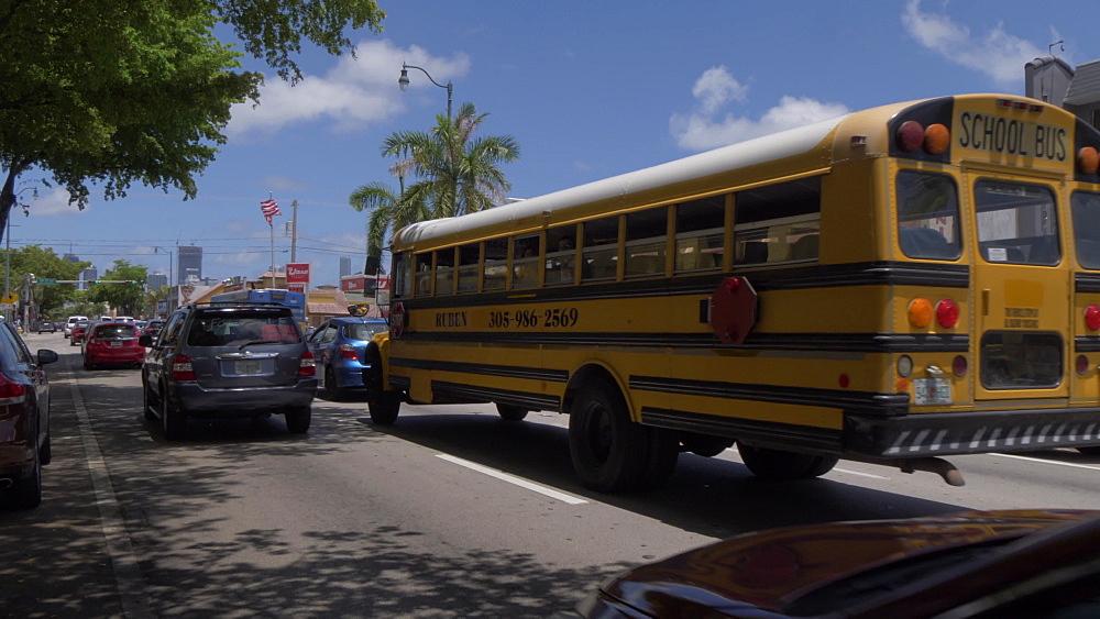 Traffic and yellow school bus on 8th Street in Little Havana, Little Havana, Miami, Florida, USA - 844-14190