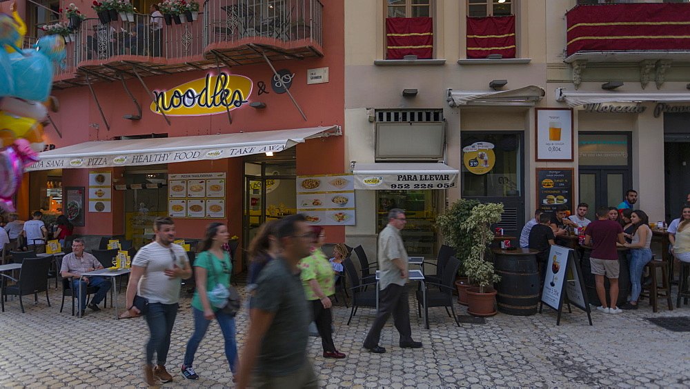 Moving time lapse of restaurants on Calle Granada in evening, Málaga, Andelucia, Spain, Europe - 844-14277