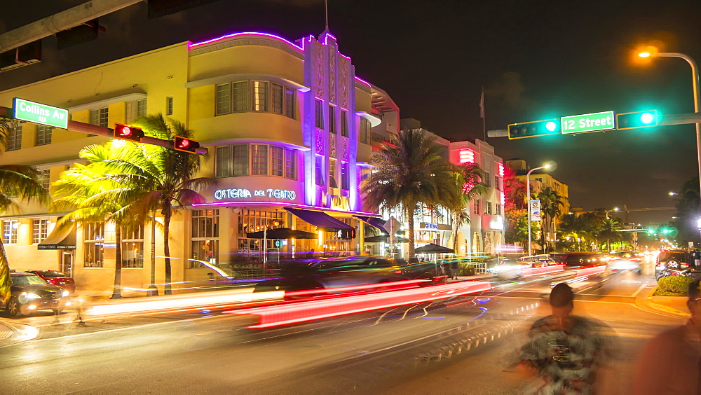 Timelapse of traffic on junction of Collins Avenue and 12 street at night, South Beach, Miami, Florida, USA - 844-14322