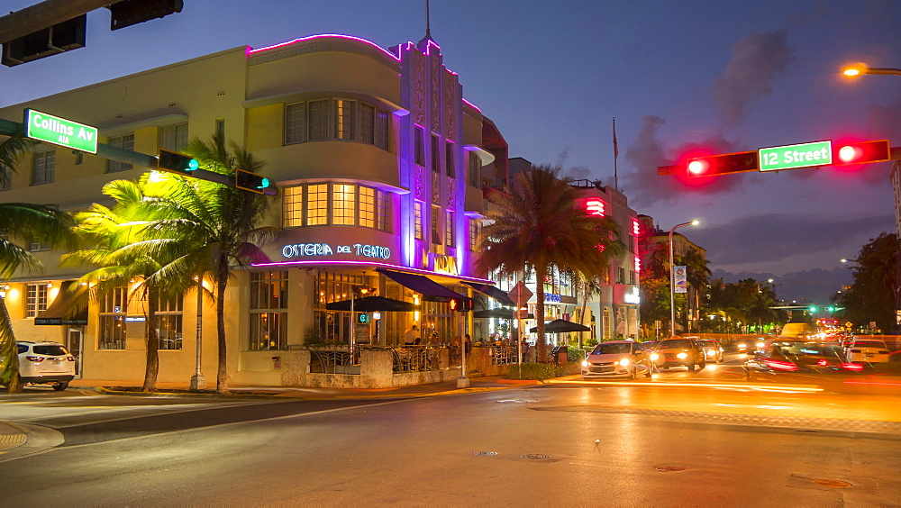 Timelapse of traffic on junction of Collins Avenue and 12 street at dusk, South Beach, Miami, Florida, USA - 844-14334