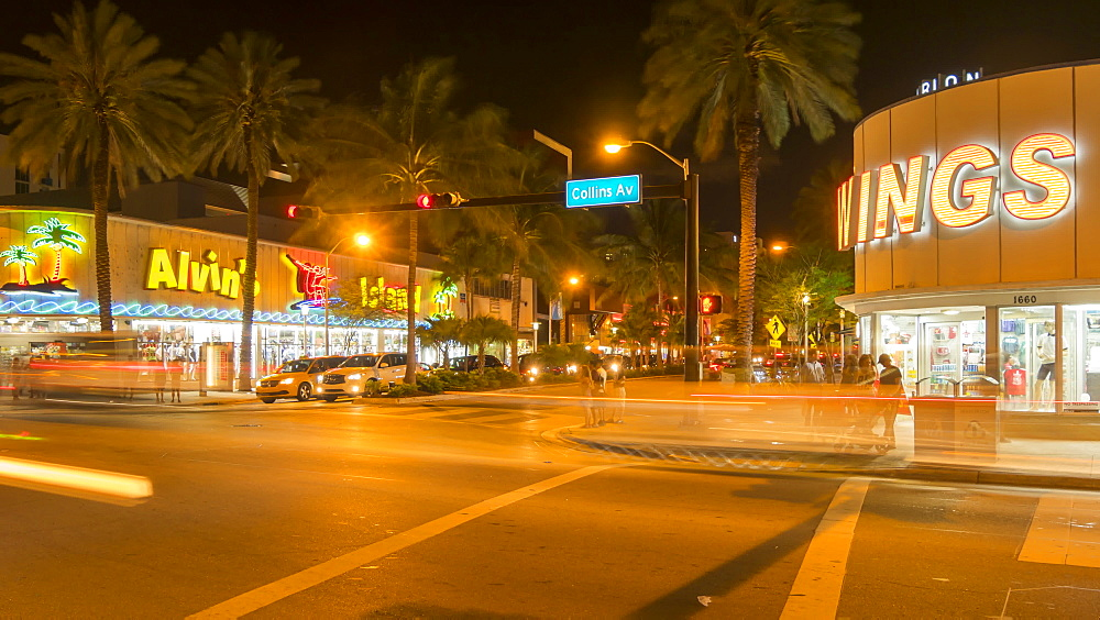 Timelapse of traffic on junction of Collins Avenue and Lincoln Avenue at night, South Beach, Miami, Florida, United States of America, North America