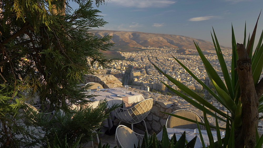 Panning shot from summit of Mount Lycabettus of restaurant and Athens, Athens, Greece, Europe