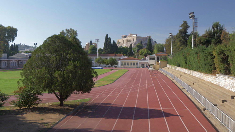 Running track of The Basilica of Ilissos and Acropolis visible in background, Athens, Greece, Europe