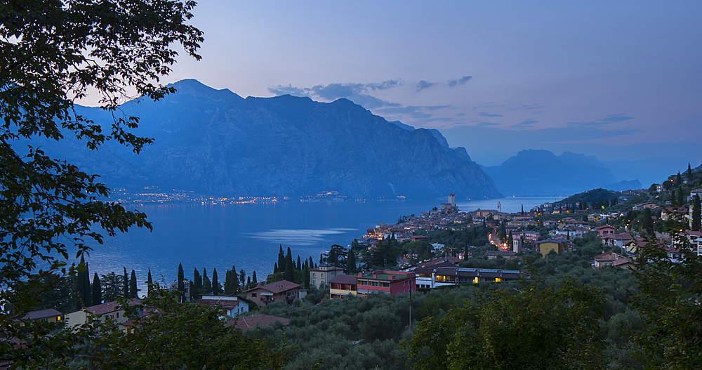 time lapse day to night elevated view of Castello Scaligero, Scaliger castle, Malcesine, Lake Garda, Veneto, Italy, Europe