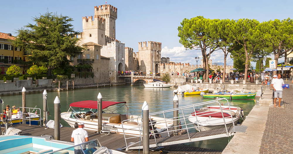 time lapse view of Scaliger Castle and harbour activity, Sirmione, Lake Garda, Lombardy, Italy, Europe