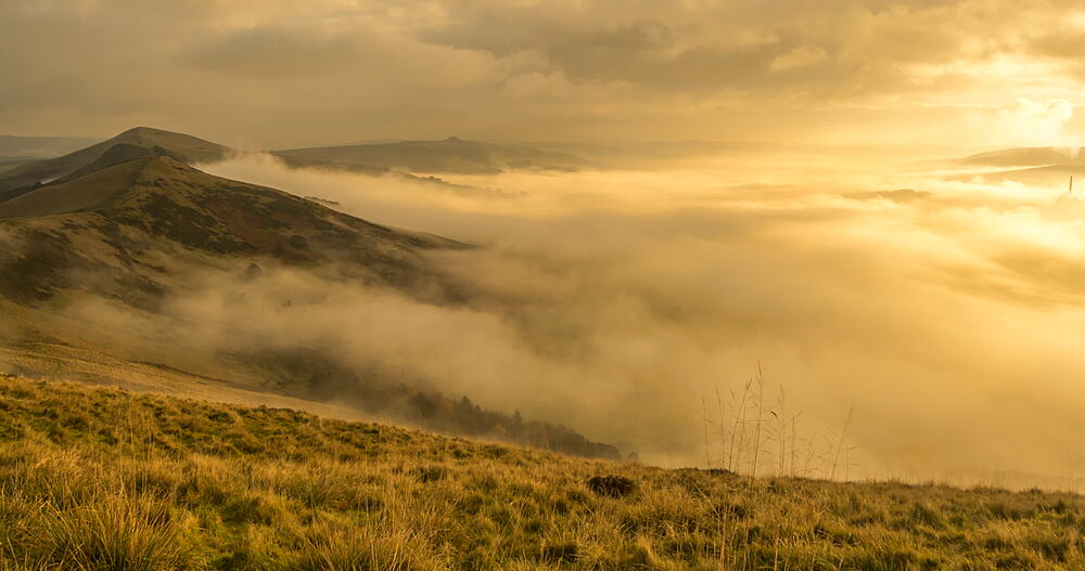 time lapse early morning mist lapping on Mam Tor, Castleton, Peak District National Park, Derbyshire, England, United Kingdom, Europe
