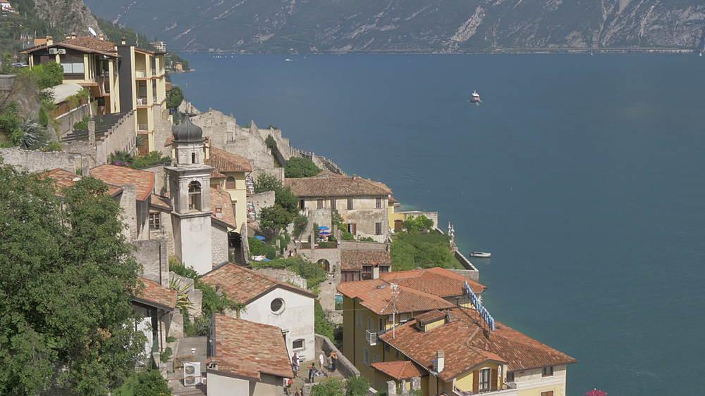 Elevated view of boat leaving Limone sul Garda, Lake Garda, Lombardia, Italy, Europe