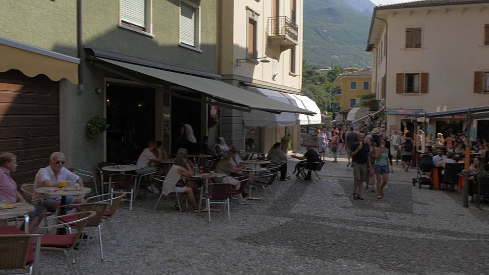 Shops and bars on narrow street in Malcesine, Lake Garda, Province of Trento, Italy, Europe - 844-15760