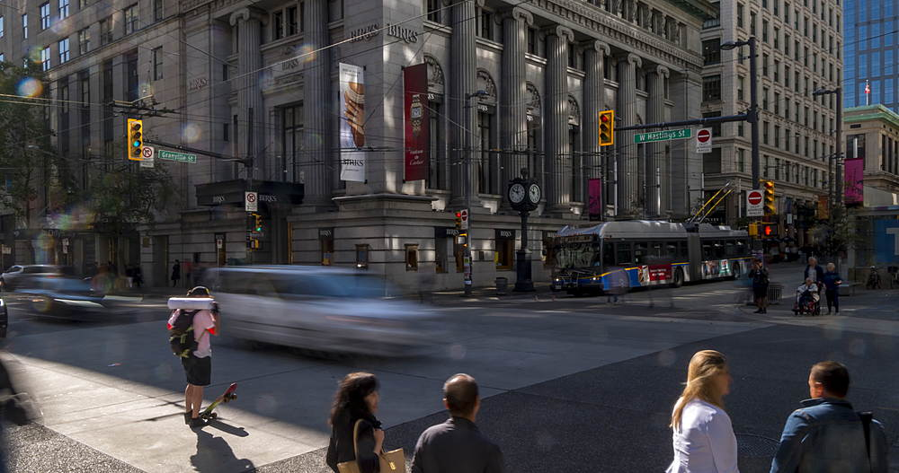 Turning Time lapse of activity on the corner of Granville Street and Hastings Street, Vancouver, British Columbia, Canada, North America