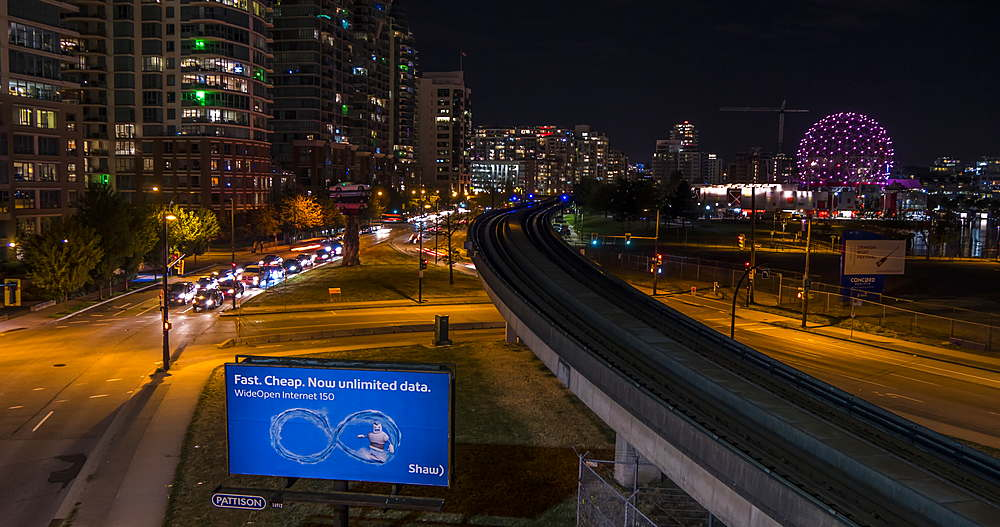 Time lapse of traffic and trams with Science World visible in background at night, Vancouver, British Columbia, Canada, North America