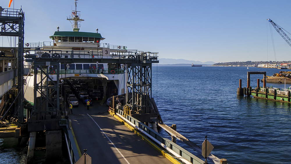 Part Turning Time lapse of passengers and vehicles loading Bainbridge Ferry and leaving, Seattle, Washington, USA, North America