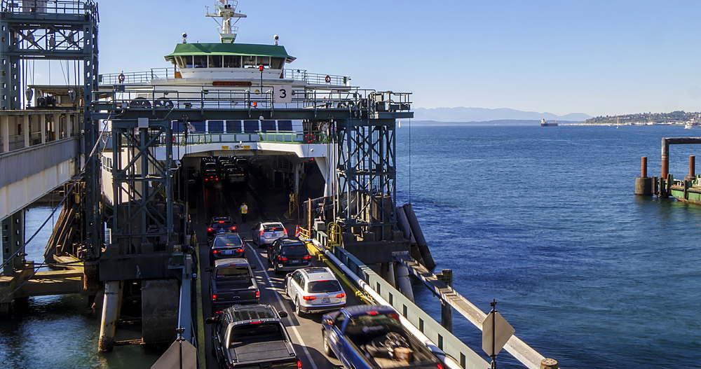 Time lapse of passengers and vehicles loading Bainbridge Ferry and leaving, Seattle, Washington, USA, North America