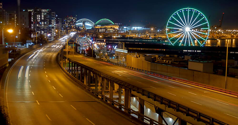 Time lapse of The Seattle Great Wheel, Pacific Highway and skyline at night, Downtown, Seattle, Washington, USA, North America