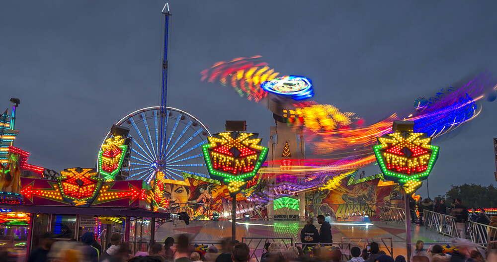 Time Lapse of fair ground rides at Goose Fair at dusk, Nottingham, Nottinghamshire, England, UK, Europe