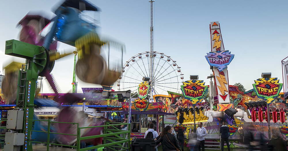Time Lapse of fair ground dodgem ride at Goose Fair at dusk, Nottingham, Nottinghamshire, England, UK, Europe