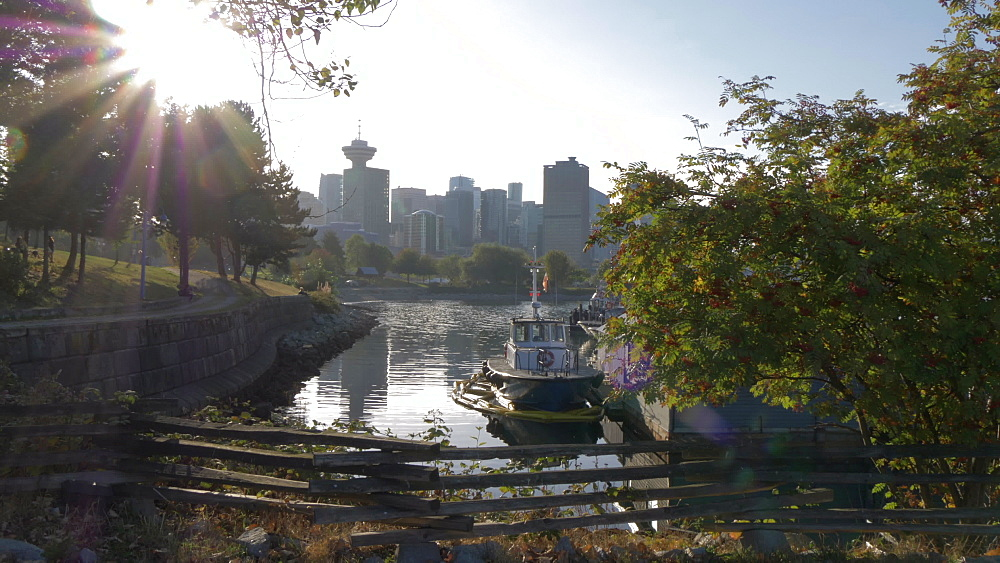 View of Downtown skyline and setting sun from CRAB Park Bayside, Vancouver, British Columbia, Canada, North America