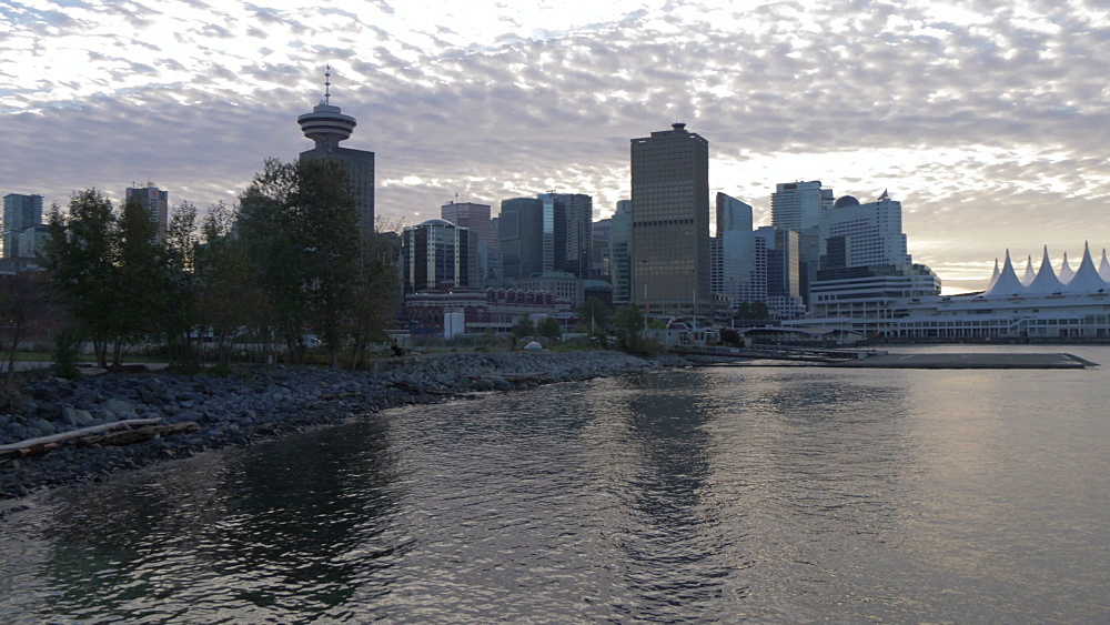 View of Canada Place and Downtown skyline viewed from CRAB Park Bayside at sunset, Vancouver, British Columbia, Canada, North America