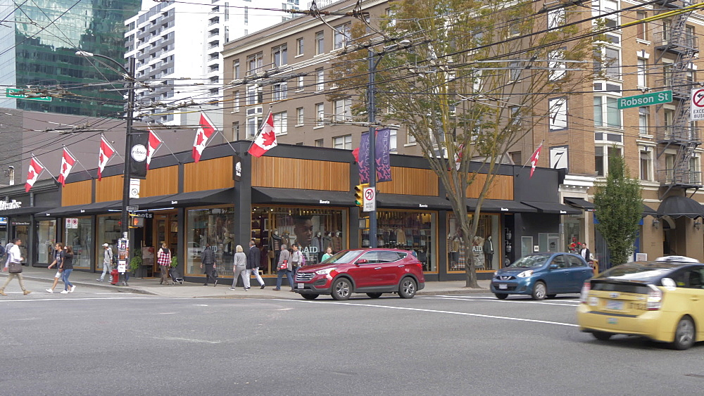 View of shops, pedestrians and traffic on Robson Street, Vancouver, British Columbia, Canada, North America - 844-16405