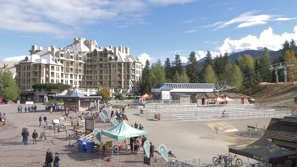 Cyclists, shops and hotels on main street, Whistler, British Columbia, Canada, North America