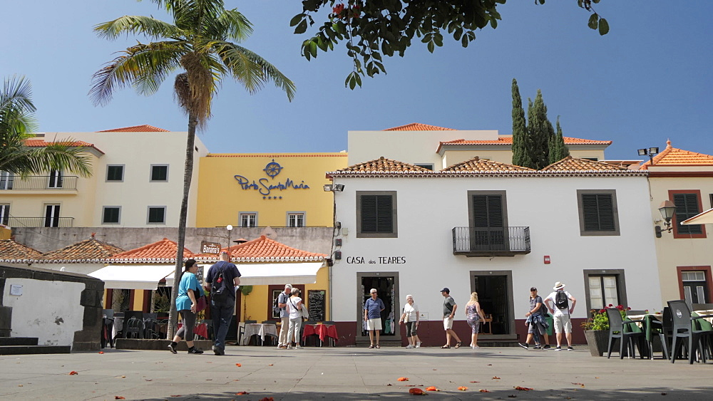 Restaurants and visitors in old town square on sunny day in Funchal, Madeira, Portugal, Atlantic, Europe