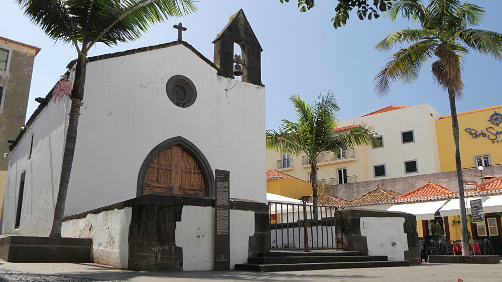 Slider shot church in old town square on sunny day in Funchal, Madeira, Portugal, Europe - 844-16438