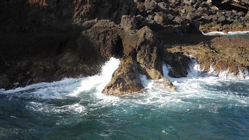 View of waves crashing on rocky coastline near Canico, Madeira, Portugal, Atlantic, Europe