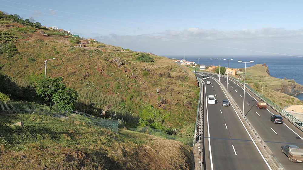 Pan shot from tumbling hillside to VR1 road near Canico, Madeira, Portugal, Atlantic, Europe