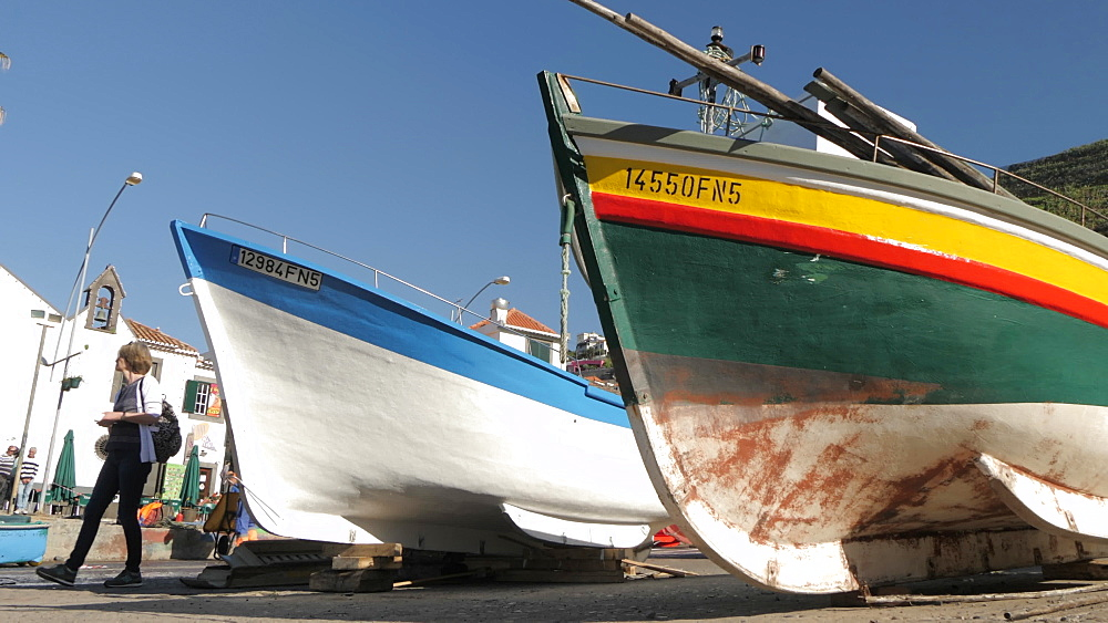 Slider shot among fishing boats in colourful harbour, Camara de Lobos, Madeira, Portugal, Europe - 844-16469