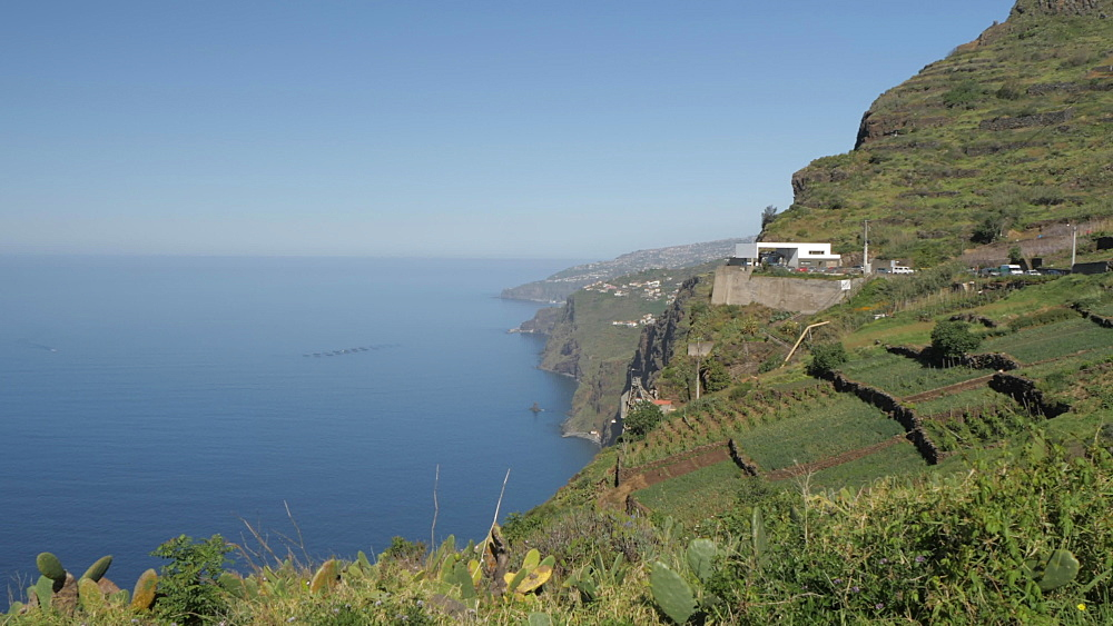 Pan shot from tumbling hillside to Faja dos Padres near Cabo Girao, Madeira, Portugal, Atlantic, Europe