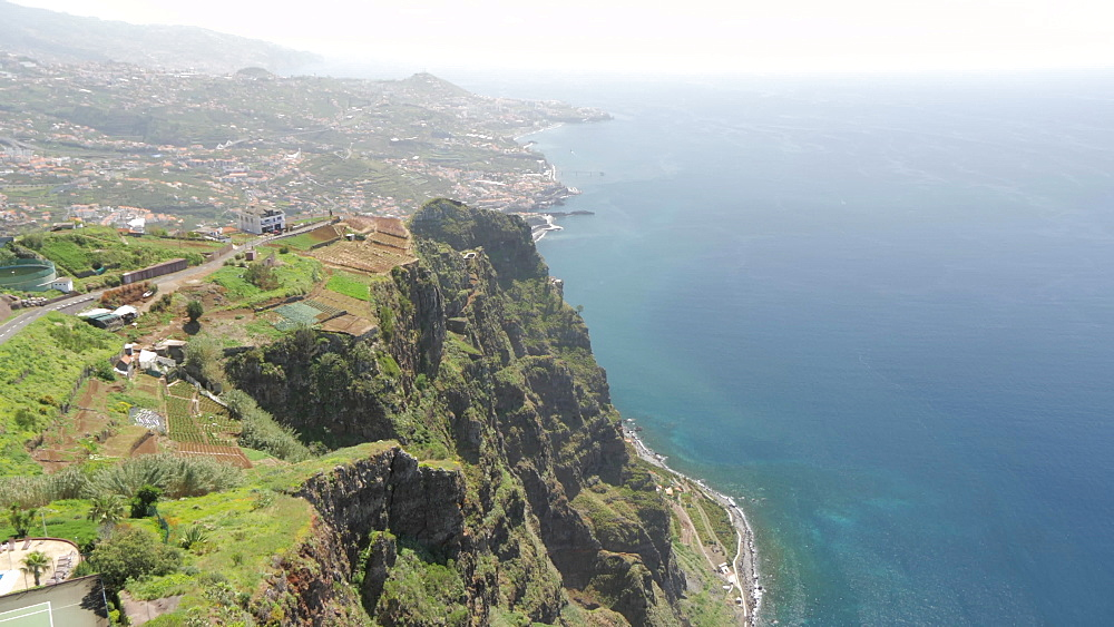 Elevated panning view from Atlantic Ocean to coastline from Cabo Girao, Madeira, Portugal, Atlantic, Europe