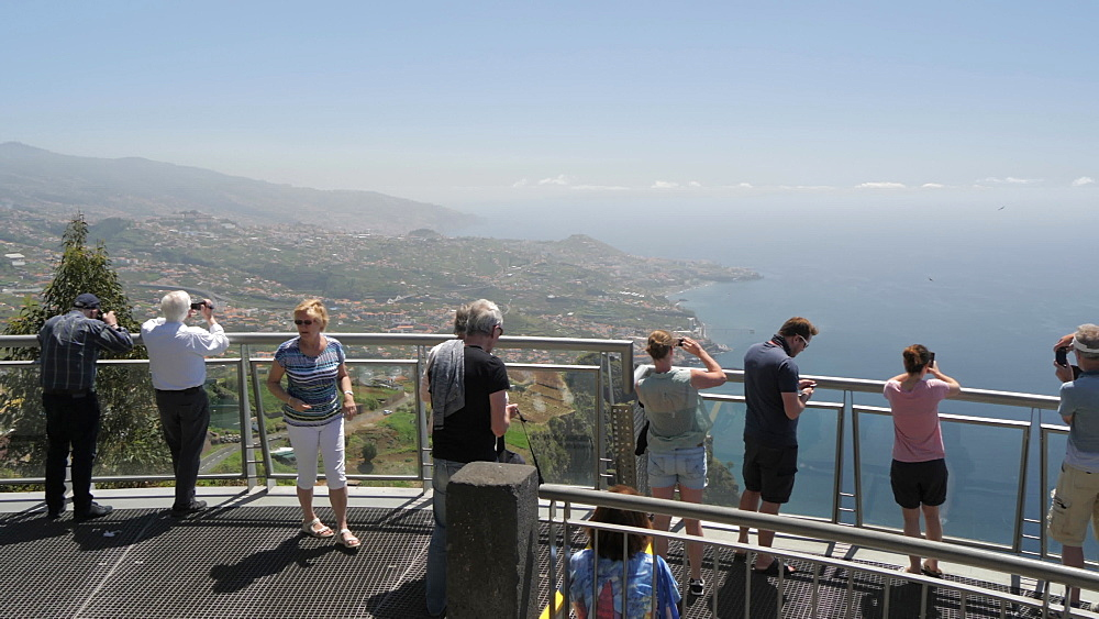 Panning view of visitors on Cabo Girao Skywalk, Cabo Girao, Madeira, Portugal, Atlantic, Europe