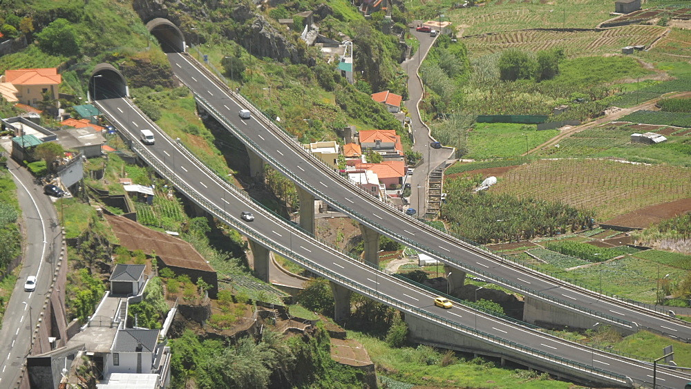 Elevated view of main road VR1 cutting through scenic landscape near Cabo Girao, Madeira, Portugal, Atlantic, Europe
