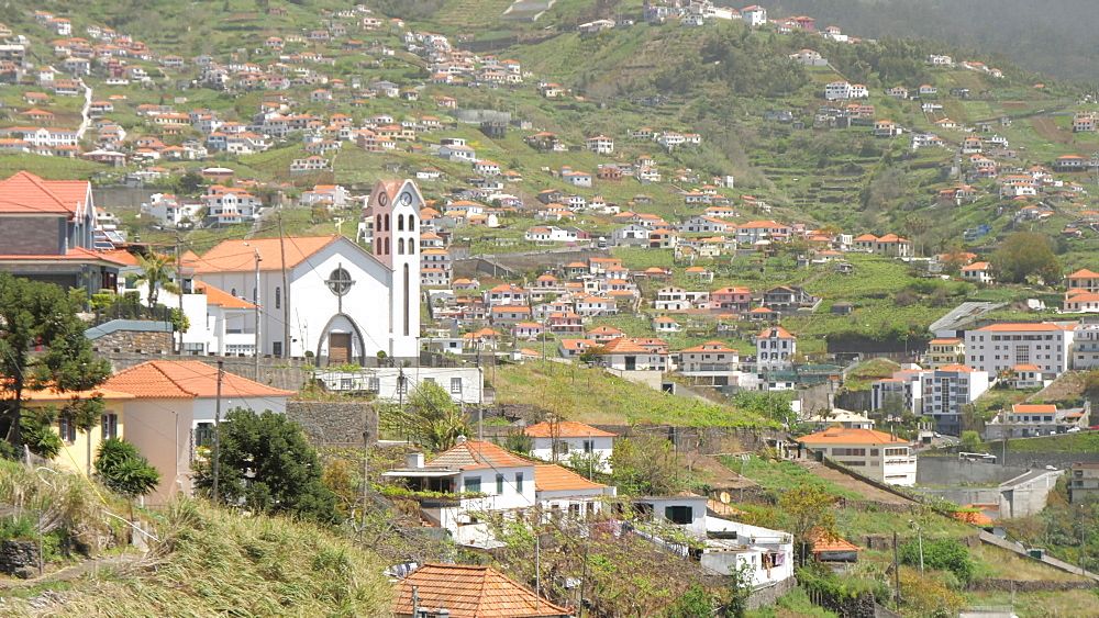 Panning shot of scenic villages and churches near Cabo Girao, Madeira, Portugal, Europe - 844-16490