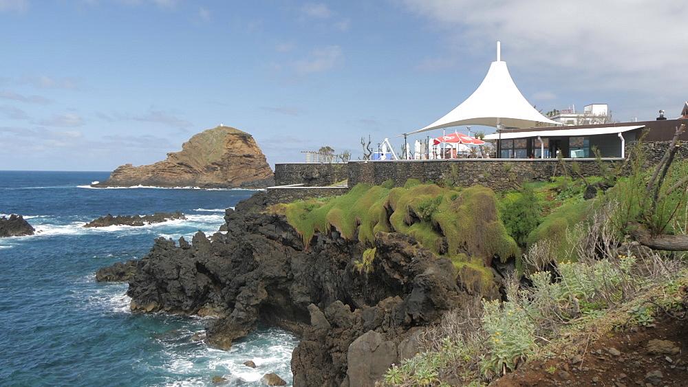 View of rugged coastline, Atlantic Ocean and cafe, Porto Moniz, Madeira, Portugal, Atlantic, Europe