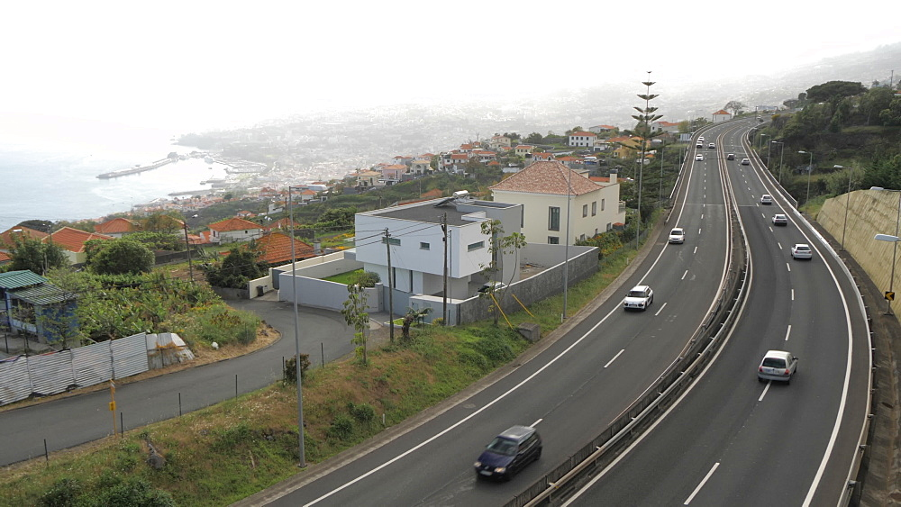 View of VR1 road and Funchal from elevated position, Funchal, Madeira, Portugal, Atlantic, Europe