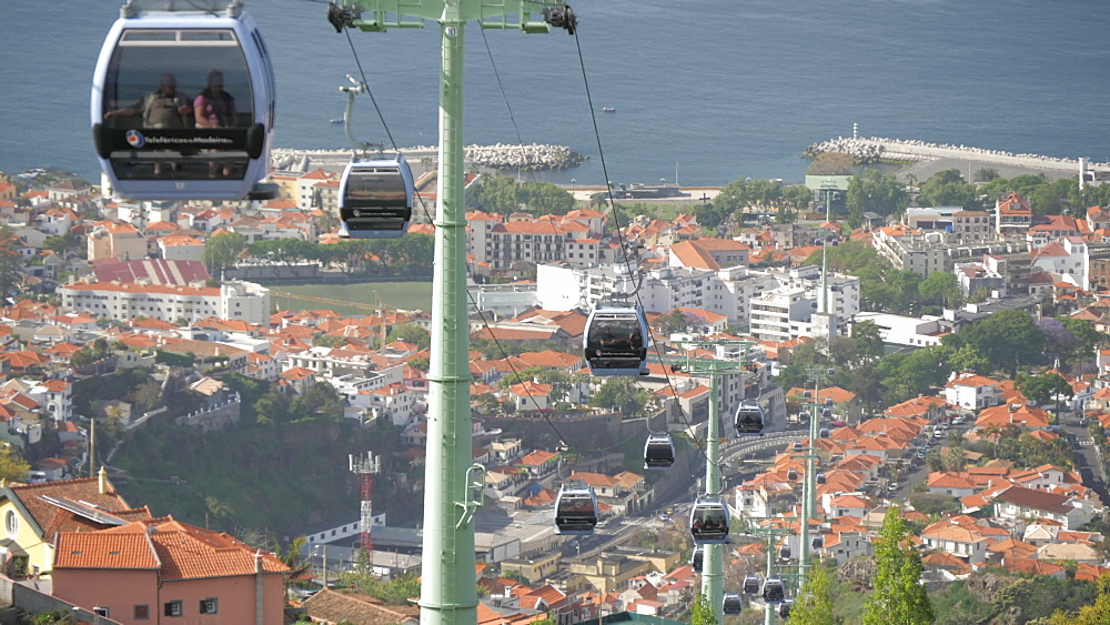 View of cable cars from Botanical Gardens with Old Town visible in background, Funchal, Madeira, Portugal, Atlantic, Europe