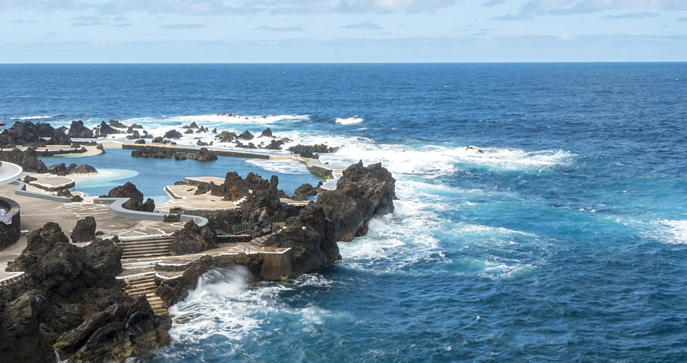View of waves breaking on rocks and natural pools at Porto Moniz, Madeira, Portugal, Atlantic, Europe